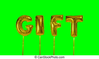 Word gift from helium golden balloon letters floating on...
