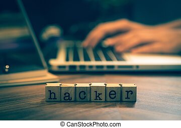 Word Hacker with hands working on notebook.