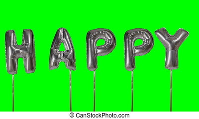 Word happy from helium silver balloon letters floating on...