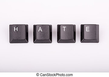 Word hate formed with computer keyboard keys on white...