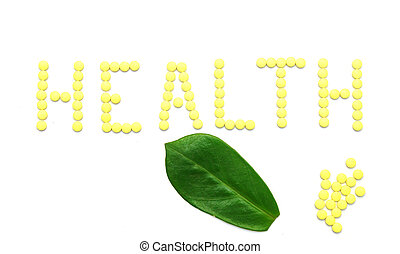 Word HEALTH made from yellow medication pills isolated on white background