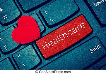 word Healthcare on keyboard.