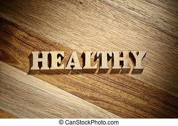 Word healthy made with wooden letters