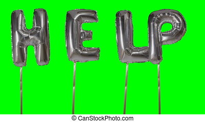 Word help from helium silver balloon letters floating on...