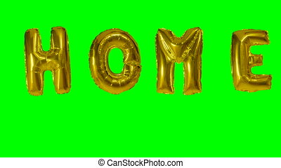 Word home from helium gold balloon letters floating on green...