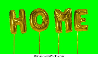 Word home from helium golden balloon letters floating on...
