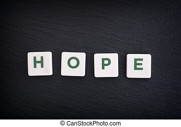 Word Hope on a black slate background