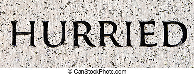 """Word """"Hurried"""" Carved in Gray Granite Stone"""