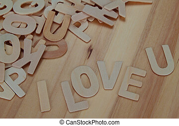 Word i love you made with wooden letters alphabet