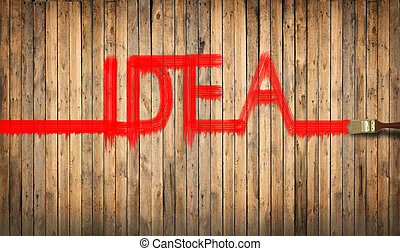Word idea written with red paint on a wooden fence. - Word...