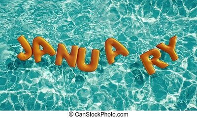 "word ""JANUARY"" shaped inflatable swim ring floating in a..."