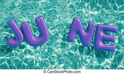 """word """"JUNE"""" shaped inflatable swim ring floating in a..."""