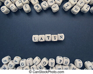 Word Latin of small white cubes on a dark background