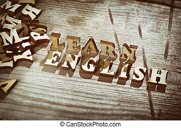 Word learn english made with wooden letters. Education...