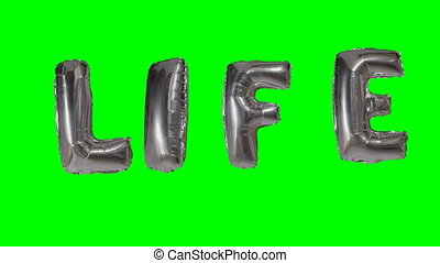 Word life from helium silver balloon letters floating on...