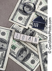 Word Loan with hundred dollar bills, business and finance concept, for mortgage or business background, copy space