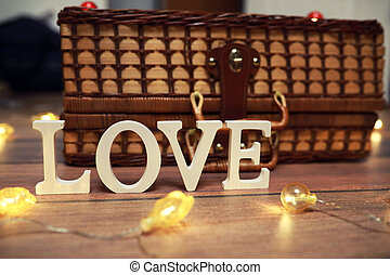 word Love from wooden letters on background