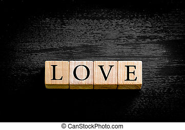 Word LOVE isolated on black background with copy space