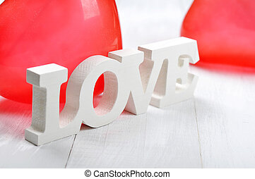 """Word """"love"""" made from wood"""