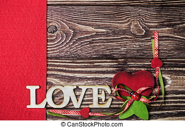 "word ""love"" made of wood on wooden background"