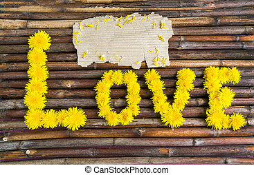 "word ""LOVE"" of yellow dandelionsokay"