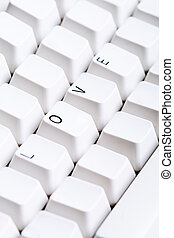 Word LOVE on computer keyboard with empty space on other buttons. May be used as symbol of love on the Internet, love e-mail letters.