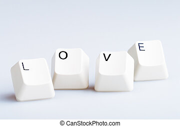 Word LOVE on computer keyboard's  buttons. May be used as symbol of love on the Internet, love e-mail letters.