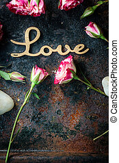 Word LOVE on rustic background - Valentine's day background