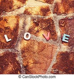 word love on the stone floor