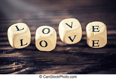 Word ''love'' on wooden background