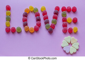 Word love spelled with candy