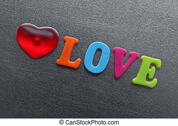 word love with red heart spelled out using colored fridge magnet