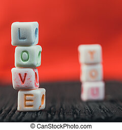 Word Love written in ceramic blocks