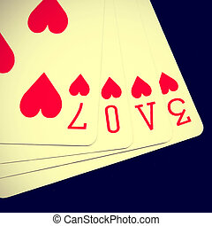 love - word love written with heart playing cards with a...