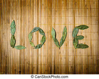 Word love written with leaves