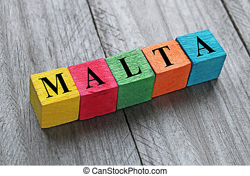 word malta on colorful wooden cubes