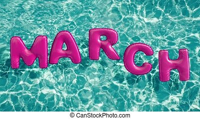 "word ""MARCH"" shaped inflatable swim ring floating in a..."