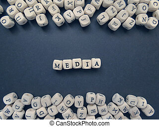 Word Media of small white cubes on a dark background