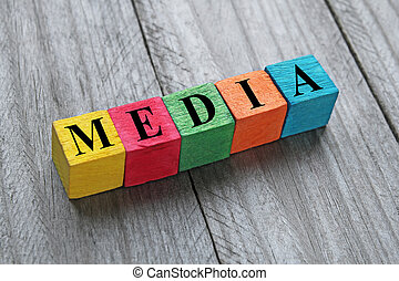 word media on colorful wooden cubes