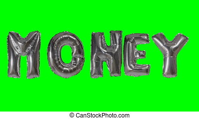 Word money from helium silver balloon letters floating on...
