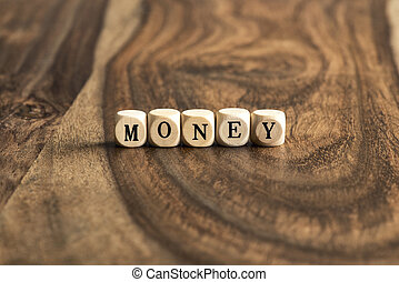 Word MONEY on wooden cubes