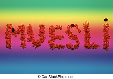 word - MUESLI abstract art toning in colors of the rainbow.