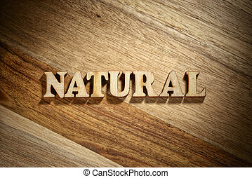 Word natural made with wooden letters
