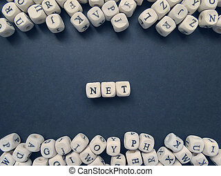 Word Net of small white cubes on a dark background