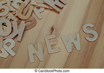 Word news made with wooden letters alphabet