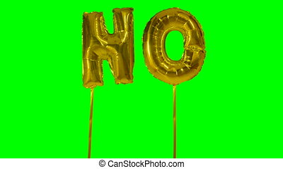 Word no from helium golden balloon letters floating on green...
