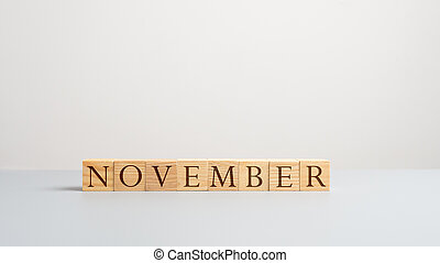 Word november on wooden cubes