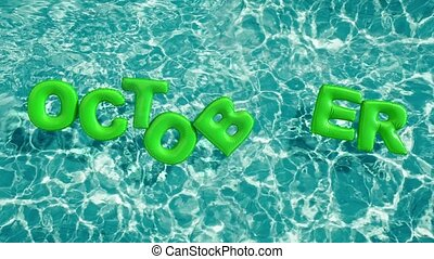 """word """"OCTOBER"""" shaped inflatable swim ring floating in a..."""