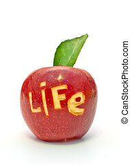 word of life cut out on a red apple