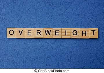 word overweight made from brown wooden letters